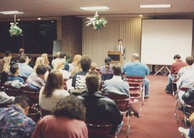 Jim Plaxco introducing Space Shuttle Astronaut Dr. Byron Lichtenberg to an audience at Harper College - Oct. 1993.