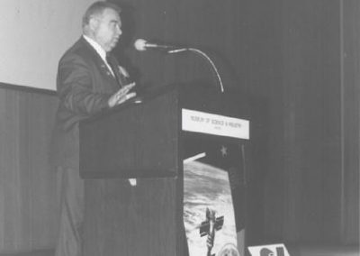 Cosmonaut Georgi Grechko speaking to an audience at Chicago's Museum of Science and Industry as part of a CSSS sponsored speaking tour of Chicago in April 1993