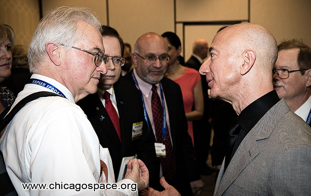 Jim Plaxco speaking with Jeff Bezos at the 2018 International Space Development Conference VIP reception