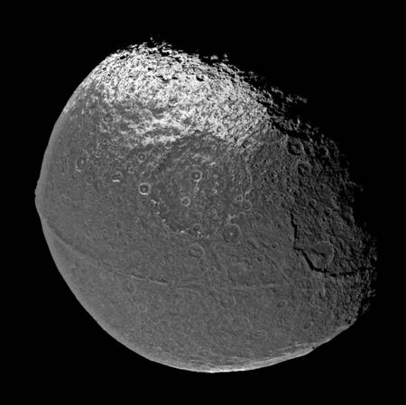 Figure 6. Cassini images Iapetus with the 'bellyband' extending along the moon's equator