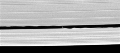 Figure 3. Cassini images the waves created by the 4-mile wide moon Daphnis orbiting within the Keeler Gap of Saturn's rings