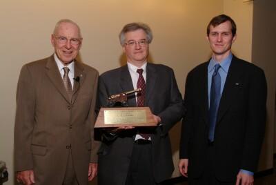 Apollo 13 astronaut James Lovell, Jim Plaxco, and NSS Executive Director George Whitesides and the Heinlein Award